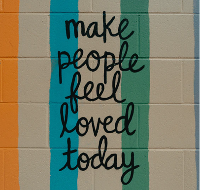 wall writing says make people feel loved today